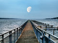 Boat pier and moon dock at dusk Royalty Free Stock Photography
