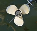 Boat propeller an isolated against the green water Stock Images