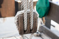 Boat pulley for sails and ropes made from wood on an old sail Royalty Free Stock Photography