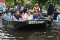 Boat rescue people wait for evacuation by mororboat on a flooded street as tens of thousands of city residents are ordered to Stock Image