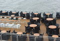 Boat restaurant tables and chairs on deck Royalty Free Stock Photo