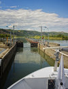 Boat in Rhone River Lock, France Royalty Free Stock Photography