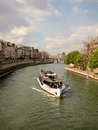 Boat on river seine a sightseeing the in paris Stock Photography