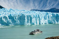 Boat sailing near Perito Moreno glacier. Royalty Free Stock Photo