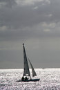 Boat sailing in the sunset small yacht Royalty Free Stock Image