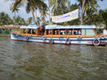 Boat for school children in india carrying to their kerala Stock Photo