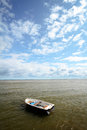 Boat in a sea little under the summer sky Stock Photo