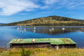 Boat shed on a bay overlooking boats on the water Royalty Free Stock Photo