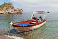 Boat at sicilian coast ioanian sea and near taormina sicily italy Stock Photo