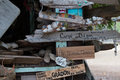 Boat signs and name plates with shells decorating a driftwood hut in Canada`s Inside Passage