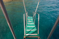 Boat stairs to the blue sea Royalty Free Stock Photo