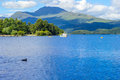 Boat on a sunny day at Loch Lomond in Luss, Scotland, UK, 21 July, 2016 Royalty Free Stock Photo
