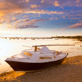 Boat sunset estany des peix in formentera balearic island beached sailboat islands of spain Royalty Free Stock Photo