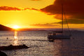 Boat and sunset in the whitsundays vivid orange queensland australia Stock Photos