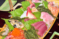 A boat of sushi with tuna, salmon, green caviar and octopus