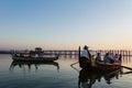 Boat in taungthaman lake is watching sunset at u bein bridge a amarapura myanmar burmar Royalty Free Stock Photo
