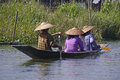 Boat with three peoples on inle lake myanmar burma Stock Photos
