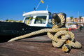 Boat tied with a rope on a mooring closeup of Stock Image
