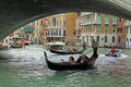 Boat traffic in venice gondols and under rialto bridge canale grande Royalty Free Stock Photo