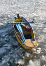Boat trapped in ice lake Royalty Free Stock Photo