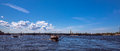 Boat trip by Neva river of Saint Petersburg under blue summer sky with bright clouds Royalty Free Stock Photo