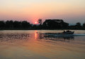 Boat trips on the river kwai and sunset Stock Image