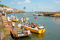 Boat trips in whitby inexpensive from the harbor around the bay entertainment for holidaymakers at east yorkshire Stock Images