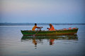 Boat in varanasi boatman rolling the the early morning Royalty Free Stock Photo