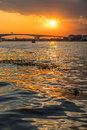Boat view from Chao Praya river on Bangkok during beautiful sunset Royalty Free Stock Photo