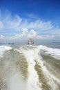 Boat wake and cargo ship