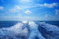 Boat wake prop wash foam in blue sky Royalty Free Stock Photo