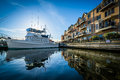 Boat and waterfront apartment building in Canton, Baltimore, Mar Royalty Free Stock Photo