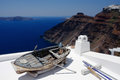 Boat on the white roof. Santorini, Greece. Royalty Free Stock Images