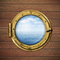 Boat window or porthole with sea or ocean horizon on wood wall Royalty Free Stock Images