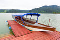Boat at wooden pier on the czorsztyn lake in poland Stock Image