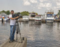 Boat and yacht show unknown inter tv channel cameraman shooting motor boats moored on display of ibys international in chervona Stock Image