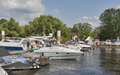 Boat and yacht show visitors visit motor boats moored on display of ibys international in chervona kalyna kiev club all the Royalty Free Stock Images