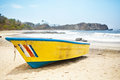 Boat yellow fishing on the beach Stock Photo