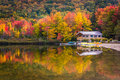 Boathouse and fall colors reflecting in echo lake in franconia notch state park new hampshire Royalty Free Stock Photos
