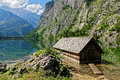 Old boathouse in scenic alpine landscape Royalty Free Stock Photo