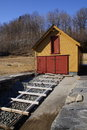 Boathouse slipway in norway traditional red yellow painted on the hardanger fjord Royalty Free Stock Image