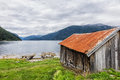 Boathouse on storfjord in norway Royalty Free Stock Photography