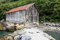 Boathouse on storfjord in norway Royalty Free Stock Photo
