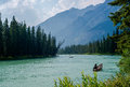 Boating bow river boaters out on the enjoyng the mountain scenery banff national park alberta canada Stock Photography