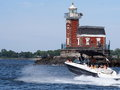 Boating past stepping stone lighthouse on a beautiful day the historic nestled between the bronx and north hemstead long island ny Stock Photography