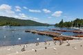 Boatjetty and birds bowness on windermere cumbria uk south lakeland the banks of lake in summer with pleasure boat jetty Stock Photography