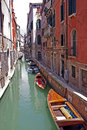 Boats aligned on venice channel Stock Photography