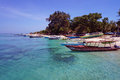 Boats along gili air island s shoreline indonesian parked the of beach with white sand and crystal clean turquoise water lined by Stock Image