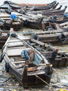 Boats along a polluted seaside in Myanmar Royalty Free Stock Photo