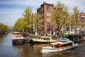 Boats on amsterdam canal prinsengracht and brouwersgracht canals in the city of netherlands north holland province Stock Image